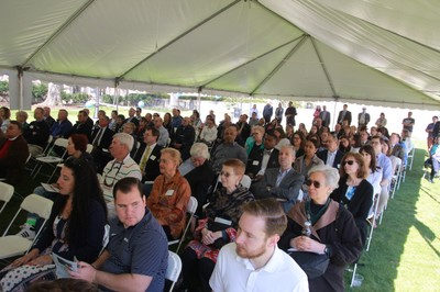 Faculty, staff, students, alumni, and other guests listen to the speeches