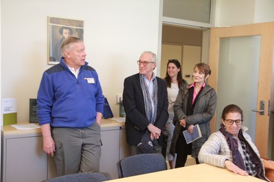 Alumni Ernie Janssen, Michael Rosenblatt, and other guests enjoy a tour of the building